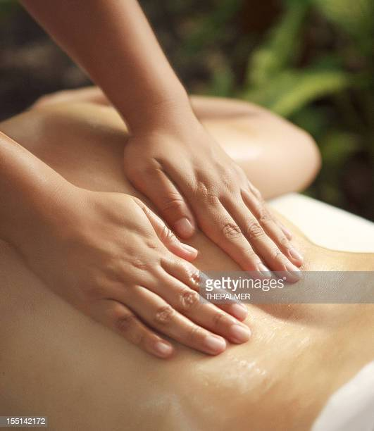relaxing massage detail - lower back stock pictures, royalty-free photos & images