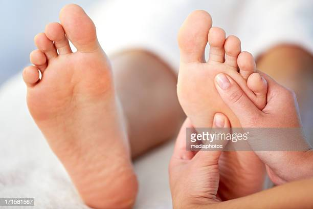 relaxing massage - female feet soles stock photos and pictures