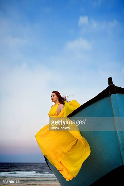 relaxing moment - yellow dress stock pictures, royalty-free photos & images