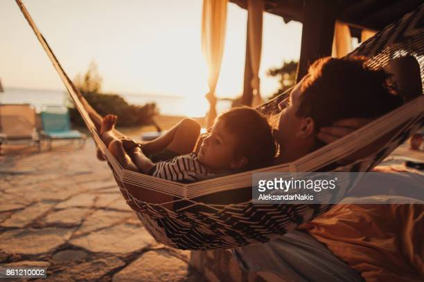 relaxing moments in a hammock - family vacation stock pictures, royalty-free photos & images
