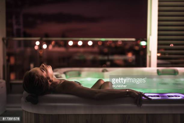 relaxing moments in a hot tub! - women of penthouse stock photos and pictures