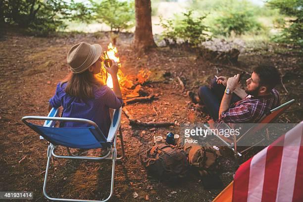 Relaxing near campfire