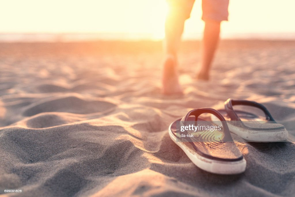 Relaxing near sea at sunset : Stock Photo