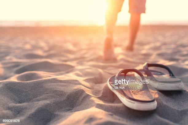 relaxing near sea at sunset - sandal stock pictures, royalty-free photos & images