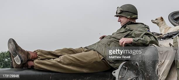 CONTENT] Relaxing on a Sherman tank barrel WW2 reenactment dog
