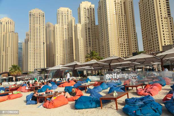 Relaxing on beanbags at a beach cafe on The Walk At JBR, Dubai.