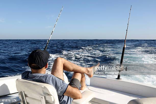 relaxing on fishing boat - fishing industry stock pictures, royalty-free photos & images