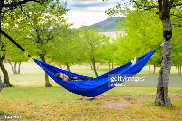 beautiful young woman relaxing hammock summer