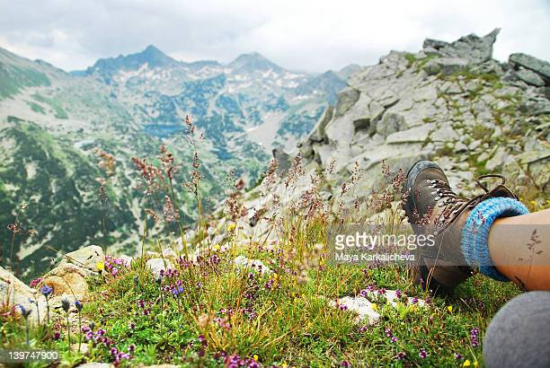 Relaxing on mountain valley with flowers ,  legs