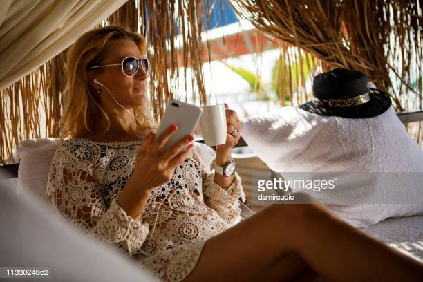 relaxing on the beach - damircudic stock photos and pictures