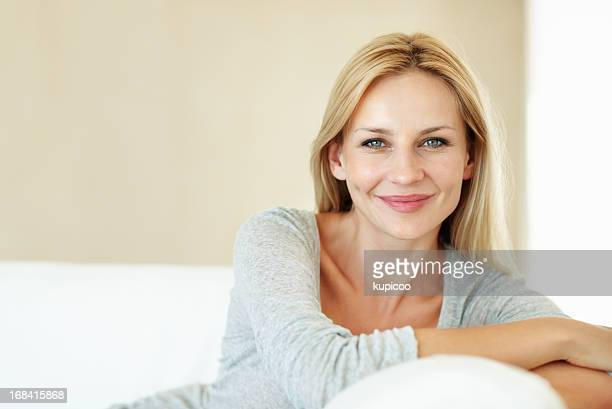 relaxing on the couch - pretty blondes stock pictures, royalty-free photos & images