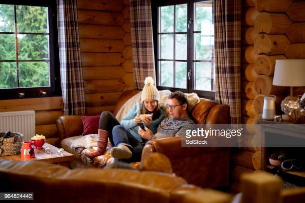 relaxing on the sofa - log cabin stock pictures, royalty-free photos & images