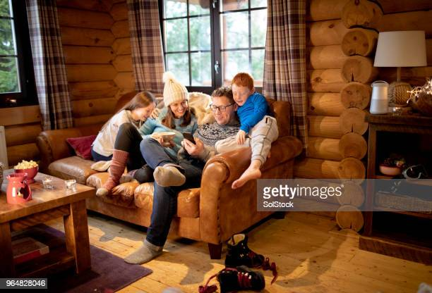 relaxing on the sofa - ski holiday stock photos and pictures