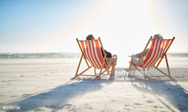relaxing on their retirement - outdoor chair stock pictures, royalty-free photos & images