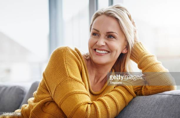 relaxing really lifts the spirits - pretty older women stock pictures, royalty-free photos & images