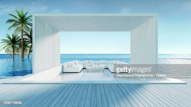 relaxing summer beach , sunbathing deck and private swimming pool with panoramic sea view at villa - tourist resort stock pictures, royalty-free photos & images