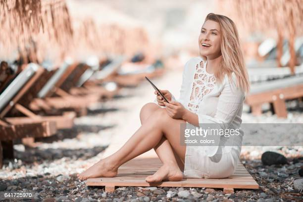 relaxing summer day on the beach - mid adult women stock pictures, royalty-free photos & images