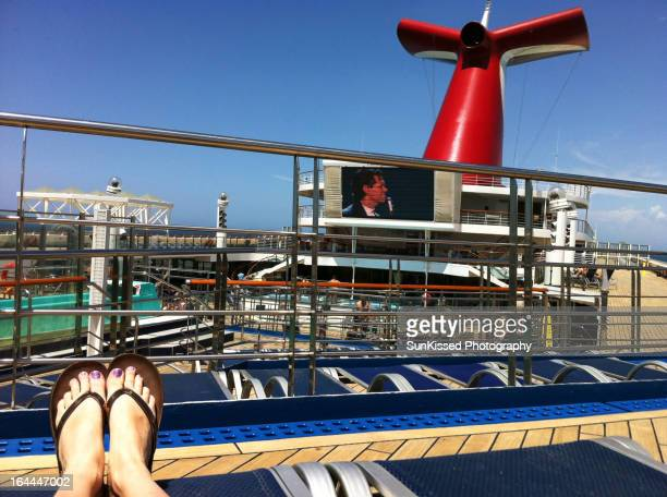 Relaxing, tanning, and enjoying the beautiful weather on deck aboard the Carnival cruise ship. No worries, thoughts, or cares. Just me, the sun, and...