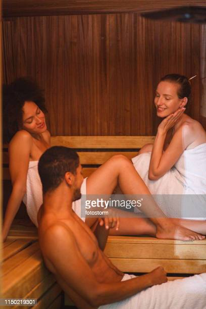 relaxing together in sauna - black woman in sauna stock pictures, royalty-free photos & images
