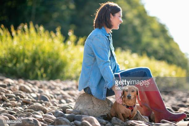relaxing together - riverbank stock pictures, royalty-free photos & images