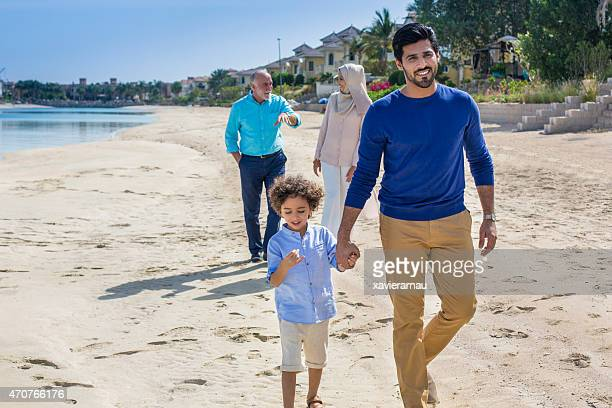 relaxing walk in the beach - middle east stock pictures, royalty-free photos & images