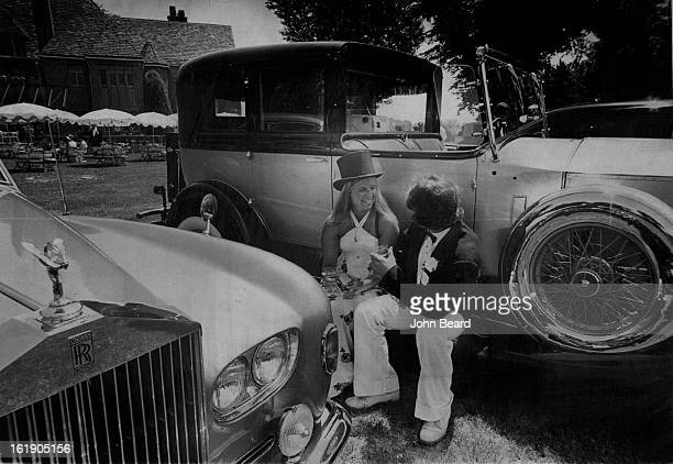 Relaxing With A Classic; Kathy Conklin, 401 Fairfax St., and H. J. Barr III, Garden City, Kan., take a break on the running board of a 1925 Rolls...