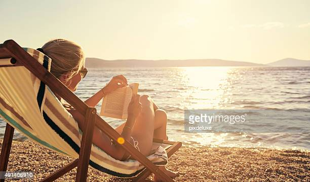 relaxing with a good book in beautiful surroundings - sunlight stock pictures, royalty-free photos & images