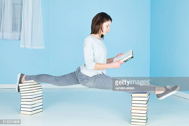 relaxing with a good book - doing the splits stock pictures, royalty-free photos & images