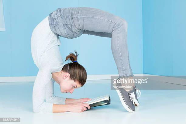 relaxing with a good book - contortionist stock pictures, royalty-free photos & images