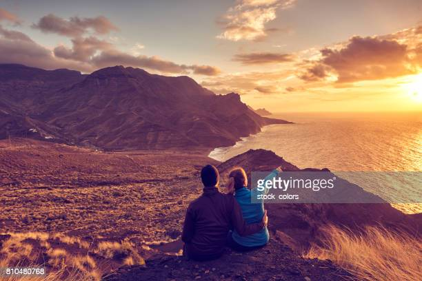 relaxing with a great sunset view - grand canary stock pictures, royalty-free photos & images