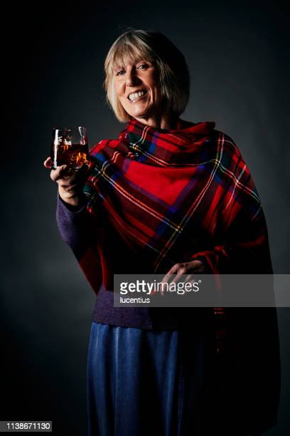 relaxing with a small glass of whisky - shawl stock pictures, royalty-free photos & images