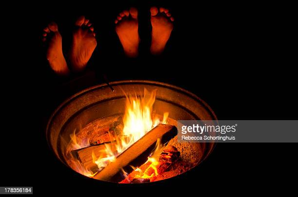 Relaxing with feet up by the campfire