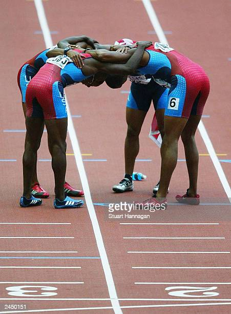S relay celebrate after winning the men's 4x100m relay final at the 9th IAAF World Athletics Championships at Stade de France on August 31 2003 in...