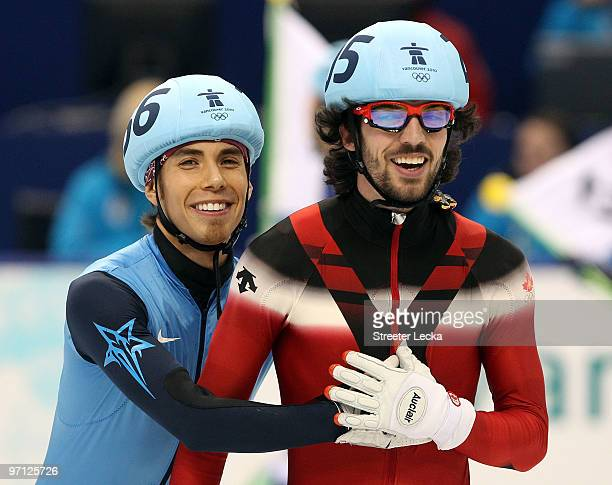 Relay Gold medalist Charles Hamelin of Canada smiles with bronze medalist Apolo Anton Ohno of the United States after the Men's 5000m Relay Short...