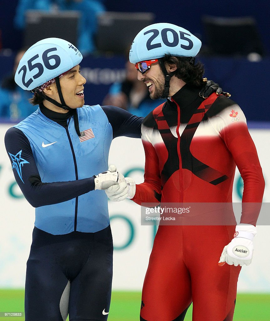 Relay Gold medalist Charles Hamelin (R) of Canada smiles with bronze medalist Apolo Anton Ohno of the United States after the Men's 5000m Relay Short Track Speed Skating Final on day 15 of the 2010 Vancouver Winter Olympics at Pacific Coliseum on February 26, 2010 in Vancouver, Canada.