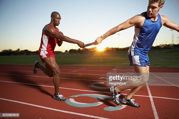 relay race - passing sport stock pictures, royalty-free photos & images