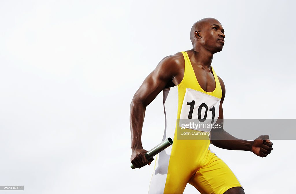 Relay Runner Holding a Baton : Stock Photo