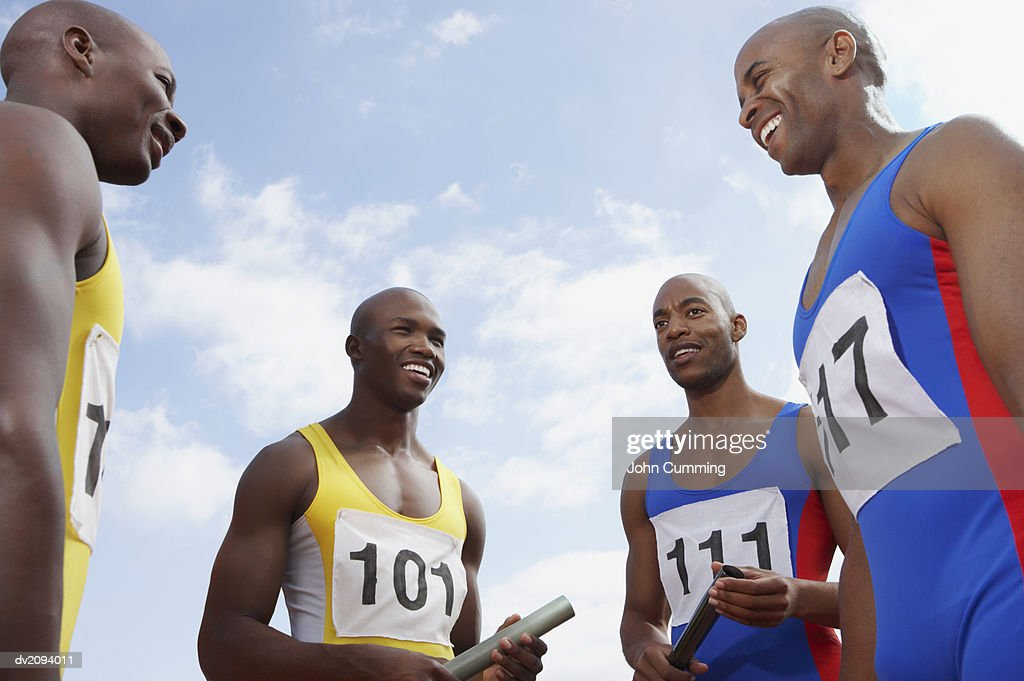Relay Runners Standing Together : Stock Photo