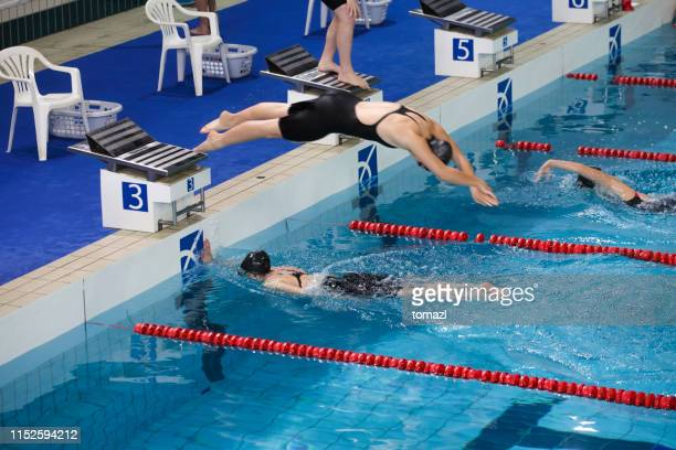 relay swimming competition - relay stock pictures, royalty-free photos & images