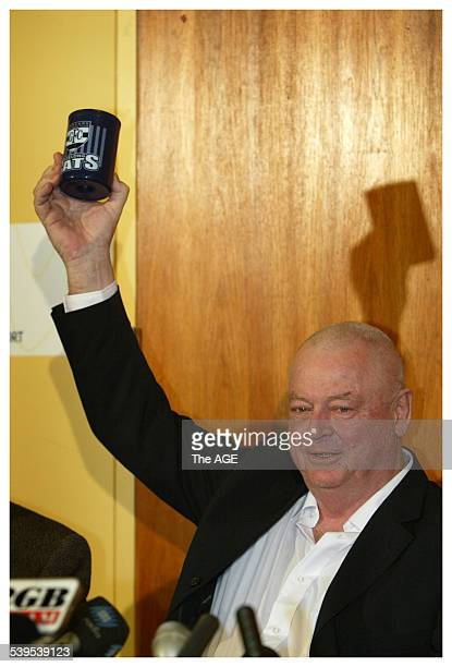 Released Australian hostage Douglas Wood holds aloft a Geelong Football Club bottle cooler at a media briefing at Melbourne Airport on his arrival...