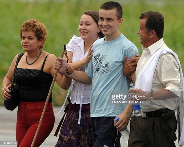 Released FARC hostage Colombian soldier Josue Calvo --abducted in April 2009-- walks next to his sister Maria Nubia Calvo , his father Luis Alberto...