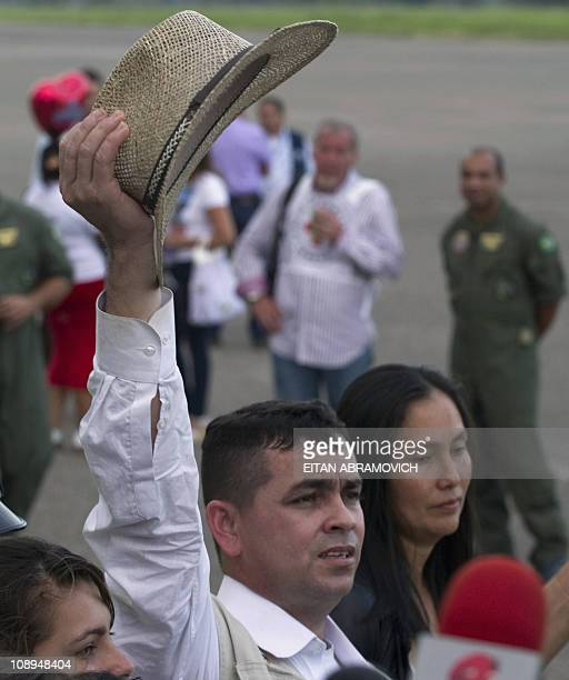Released FARC hostage, the councilman of San Jose del Guaviare Marcos Baquero, --abducted in June 2009-- raises his hat upon arriving at...