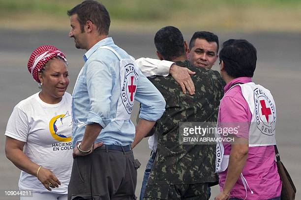Released FARC hostage the councilman of San Jose del Guaviare Marcos Baquero abducted in June 2009 is greeted by a Brazilian soldier next to...