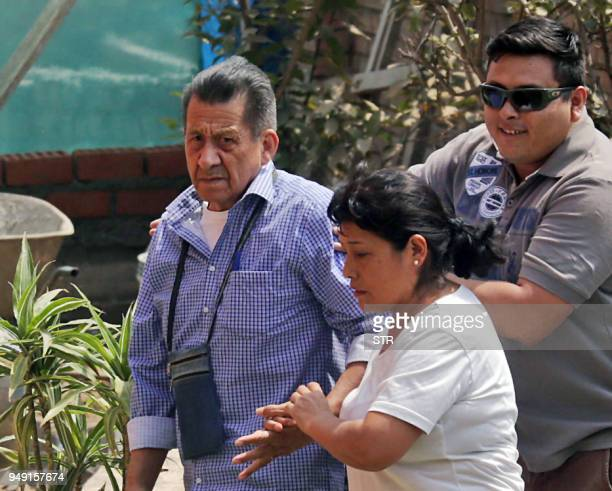 Released former maoist guerrilla leader Osman Morote is greeted by unidentified relatives upon his arrival to his house arrest in Chaclacayo a lower...