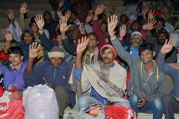 Released Indian fishermen prisoners wave after crossing the IndiaPakistan border at Wagah some 35kms west of Amritsar on January 6 after their...