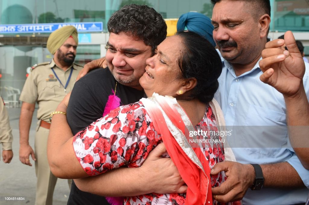 Released Indian former prisoner Sandeep Singh Sanger who was on death row in Dubai is greeted by his sister Harjinder Kaur and brother Yashwinder...