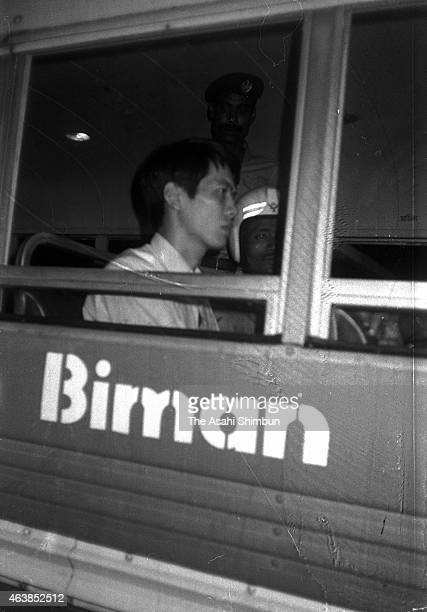 Released Japanese Red Army member Junzo Okudaira is transferred to a aircraft at Dhaka Airport on October 2 1977 in Dhaka Bangladesh Five members of...