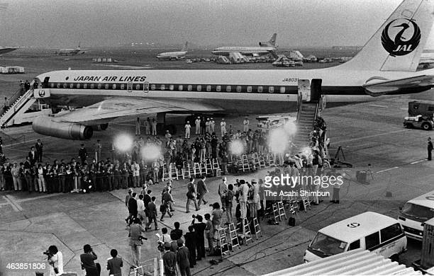 Released Japanese Red Army members walk toward a special aircraft heading to Dhaka where the exchange would be taken place at Haneda Airport on...