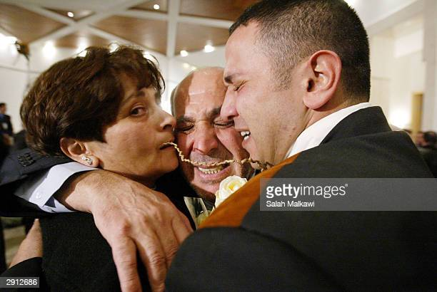 Released Lebanese prisoner is greeted by his relatives upon his arrival at Beirut International Airport January 29, 2004. A prisoner swap with the...
