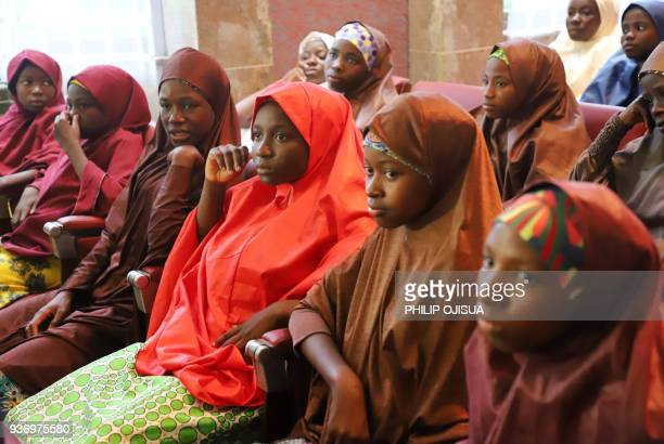 Released Nigerian school girls who were kidnapped by Boko Haram from their school in Dapchi in the northeastern state of Yobe sit at the Presidential...